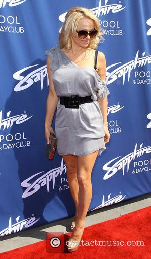Pamela Anderson - The Grand Opening of the Sapphire Pool...