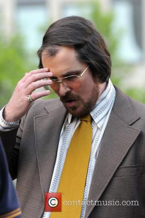 Christian Bale - The cast of 'American Hustle' filming scenes on location in Manhattan - New York City, NY, United...
