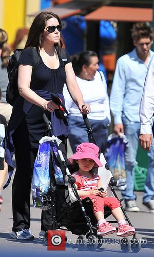 Kyla Weber and Lockly Vaughn - Vince Vaughn and his pregnant wife Kyla take their daughter to Disneyland for the...