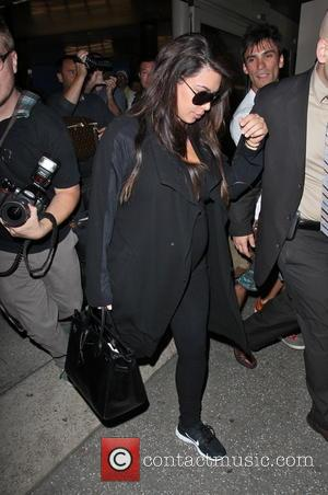 Kim Kardashian - Kim Kardashian and her mother at LAX