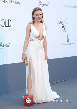 Kylie Minogue - 66th Cannes Film Festival - amfAR's 20th Annual Cinema Against AIDS 2013 - Arrivals - Cannes, France...