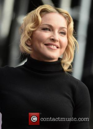 Madonna Heads To Haiti To Visit Ex-husband Sean Penn's Aid Projects