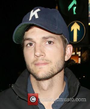 Ashton Kutcher - Ashton Kutcher and Mila Kunis leave The...