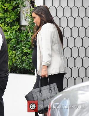 Kim Kardashian - Kourtney Kardashian seen with her infant daughter Penelope leaving a baby class - Beverly Hills, CA, United...