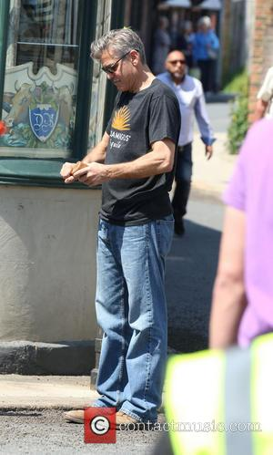 George Clooney - George Clooney filming and directing the movie 'The Monuments Men' on location in Rye - Sussex, United...