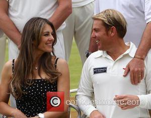 Elizabeth Hurley and Shane Warne - Elizabeth Hurley and Shane Warne host a cricket match between an Australian 11 and...