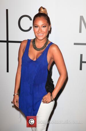 Adrienne Bailon Made Up Fake Boyfriend To Deter Rob Kardashian