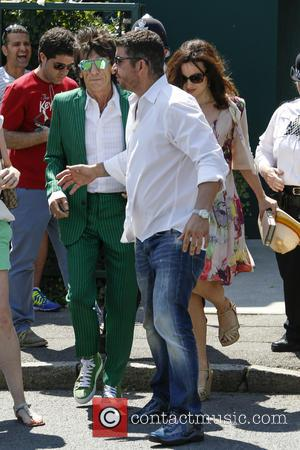 Ronnie Wood and Sally Humphreys - Wimbledon Tennis Championship 2013 - Mens Final Day - Celebrity Sightings - London, United...