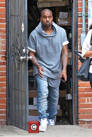 Kanye West Heading To Jail? Rapper Attacks Another Paparazzi!