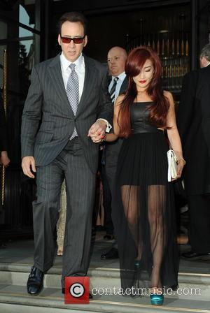 Nicholas Cage and Alice Kim - Nicholas Cage and wife Alice Kim are seen leaving their London hotel - London,...