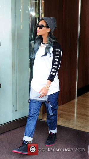 Furious Rihanna Sues Topshop Over Use Of Her Image On T-shirt