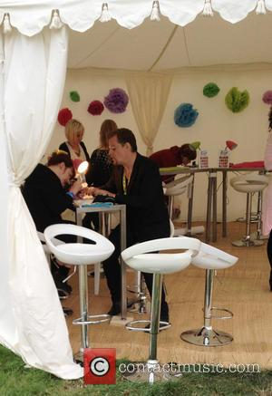 Eddie Izzard - Comedian Eddie Izzard stops by the beauty tent for a manicure at V Festival 2013 held at...
