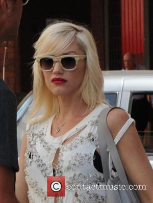 Gwen Stefani Shows Off Baby Bump  On Red Carpet