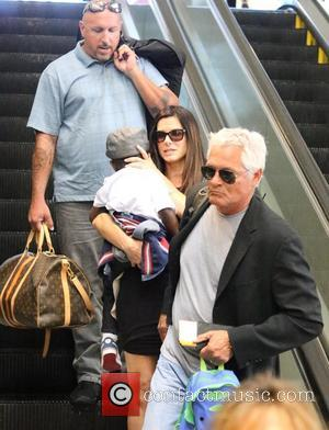 Sandra Bullock and Louis Bullock - Sandra Bullock, along with her son Louis and a bodyguard, arrive at LAX airport...