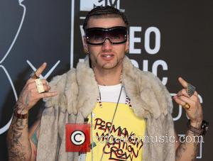 Rapper Riff Raff Storms Offstage After Beer Can Missile