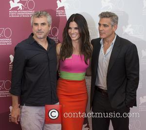 Alfonso Cuaron, George Clooney and Sandra Bullock