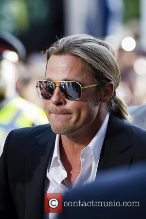 Brad Pitt Poses With Newlyweds On Their Big Day