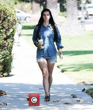 Lana Del Rey - Lana Del Rey walking around Larchmont Village wearing a denim shirt and matching Daisy Duke-style shorts...
