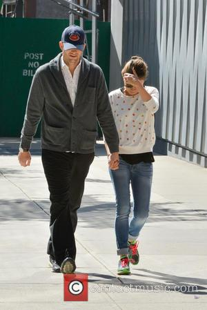 Ashton Kutcher & Mila Kunis Share A Kiss At Basketball Game