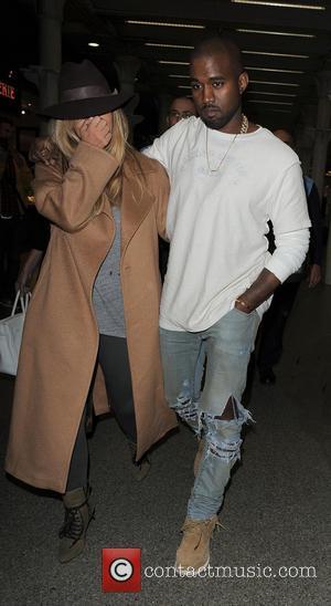 Kim Kardashian - Kim Kardashian and Kanye West arrive at...