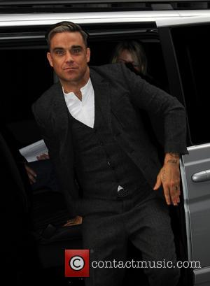 Robbie Williams - Robbie Williams arrives at Magic FM - London, United Kingdom - Wednesday 9th October 2013