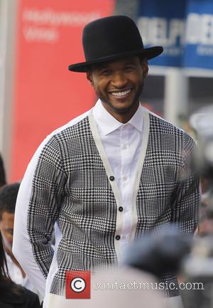 Usher Loses Out At Charity Auction After $80,000 Bid