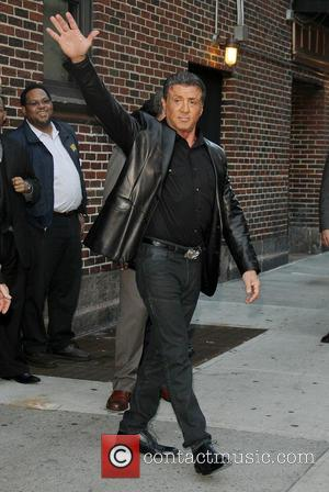 Sylvester Stallone's Russian Art Show Opens Amid Communist Protests