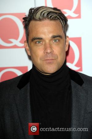 Robbie Williams Opens Up About Struggles With Potential Asperger's Syndrome