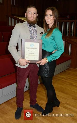Conor McGregor and girlfriend Dee Devlin - UFC fighter Conor McGregor receives the Honorary Life Membership of The Commerce &...