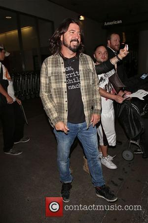 Dave Grohl - Dave Grohl  enjoys being in Los Angeles after leaving LAX , with smiles and attitude towards...