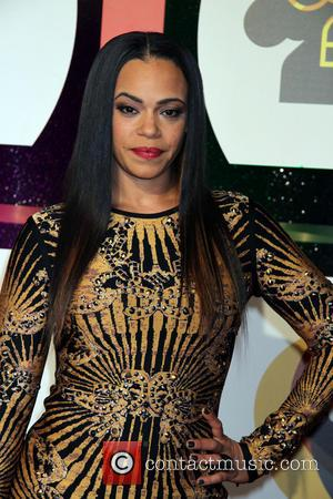 Faith Evans - Soul Train Awards 2013 Held At Orleans Arena At Orleans Hotel and Casino In Las Vegas, NV...