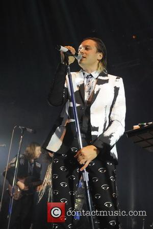 Arcade Fire and Win Butler