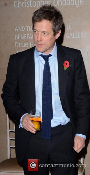 Hugh Grant - Bryan Adams: Wounded: The Legacy of War - book launch party at the National Portrait Gallery, London...