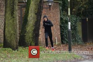 Harry Styles - EXCLUSIVE The rain did not put off One Directions' Harry Styles from going for a run. He...