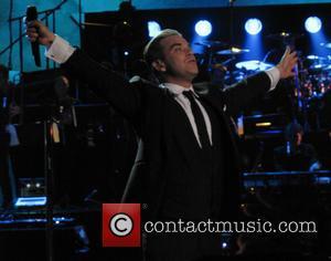 Robbie Williams Lands Britain's 1,000th Album Number One
