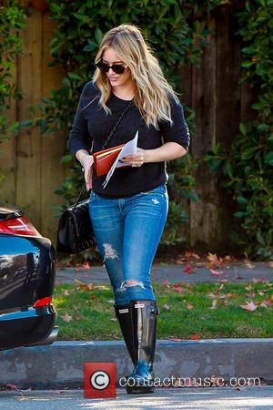 Hilary Duff - Hilary Duff dresses down wearing an old jumper, ripped jeans and Hunter wellies as she leaves Baby...
