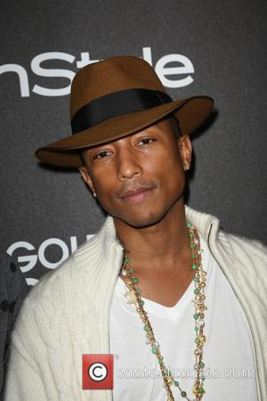 Pharrell Reclaims The UK No. 1 Spot From Pitbull & Ke$ha