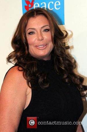 Kelly Lebrock Charged For Drunk Driving