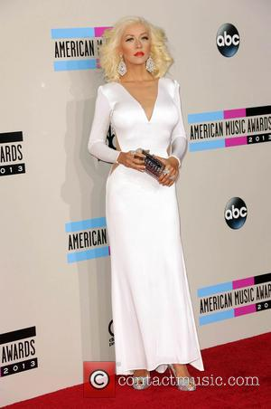 Christina Aguilera Shares Baby Bump Snap