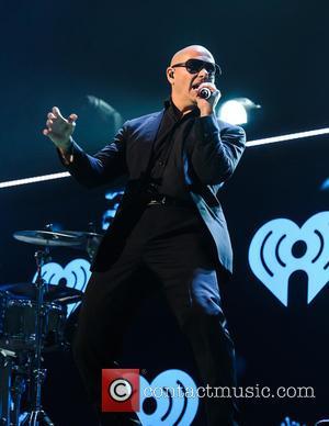 Pitbull Enters Into Partnership With Playboy Enterprises