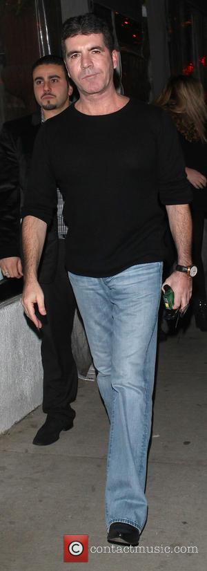 Simon Cowell - Simon Cowell and Lauren Silverman arrive at Sur restaurant to have dinner together - Los Angeles, California,...