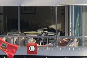 Simon Cowell and Lauren Silverman - Simon Cowell and his heavily pregnant girlfriend Lauren Silverman take a break on the...