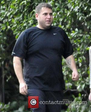 Jonah Hill - Jonah Hill and new girlfriend Isabelle McNally go for an evening hike with a friend in Runyon...