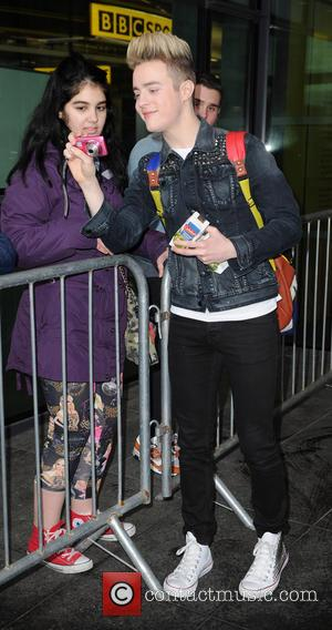 Jedward - Jedward leave the BBC Breakfast Studios. One of the twins appears to be rather proud of his bag...