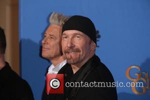 Adam Clayton (l) and The Edge of U2 - 71st Annual Golden Globes - Press Room - London, United Kingdom...