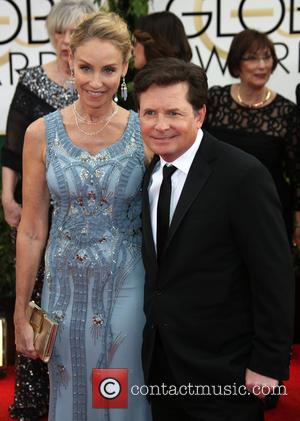 Michael J. Fox and Tracy Pollan - 71st Annual Golden Globes - Red Carpet Arrivals - Los Angeles, California, United...