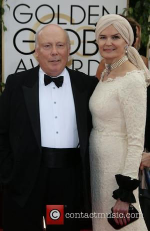 Julian Fellowes and Emma Kitchener-Fe - 71st Annual Golden Globe Awards held at The Beverly Hilton Hotel  - Red...