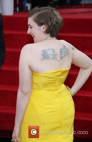 Lena Dunham - 71st Annual Golden Globe Awards held at The Beverly Hilton Hotel  - Red Carpet Arrivals -...