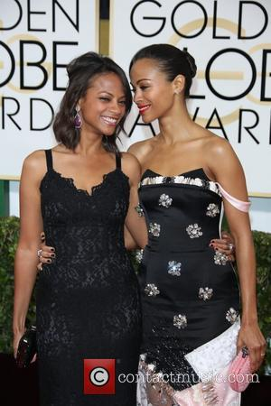 Zoe Saldana (r) and Cicely Saldana - 71st Annual Golden Globe Awards held at the Beverly Hilton Hotel - Arrivals...