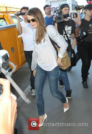Keri Russell - Keri Russell arrives at Los Angeles International Airport (LAX) in jeans and white high heels - Los...